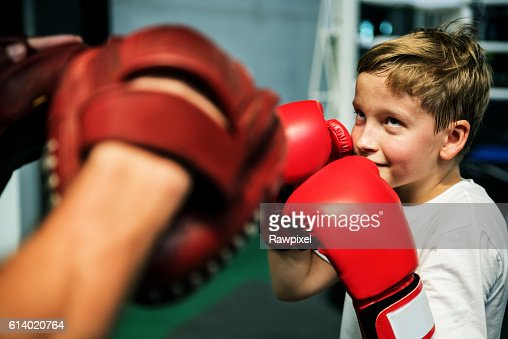 Boy Boxing Training Punch Mitts Exercise Concept : Stock Photo