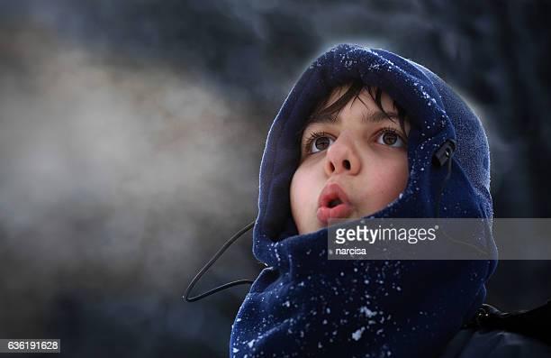Boy breath in winter