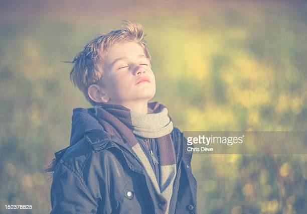 Boy breathing fresh air