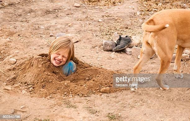 Boy Buried in Dirt
