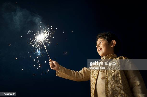 Boy burning fire crackers on Diwali
