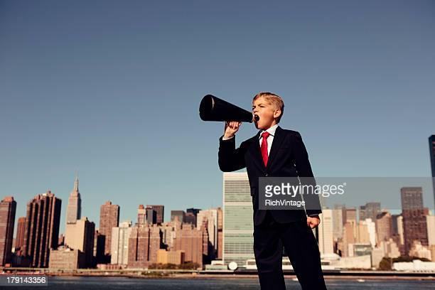 Boy Businessman Yells Through Megaphone in New York City
