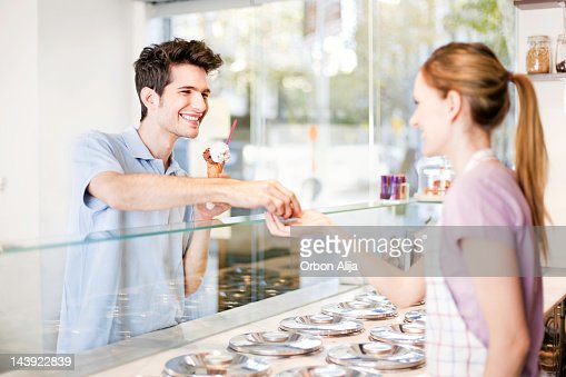 Boy buying an ice cream : Stock Photo