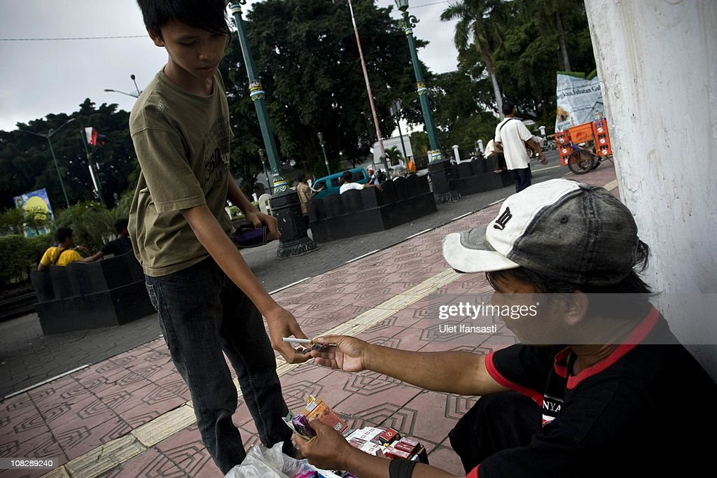 A boy buys a cigarette from a vendor on January 24, 2011 in Yogyakarta, Indonesia. It is estimated that over 25 percent of children in Indonesia over the age of three have tried smoking, with over three percent of them smoking regularly. The lack of government regulation around advertising is blamed for the problem, with campaigns seen heavily at sporting events, music concerts. The Indonesian government previously passed a health bill in 2009 to address the issues, but it has not yet been implemented.