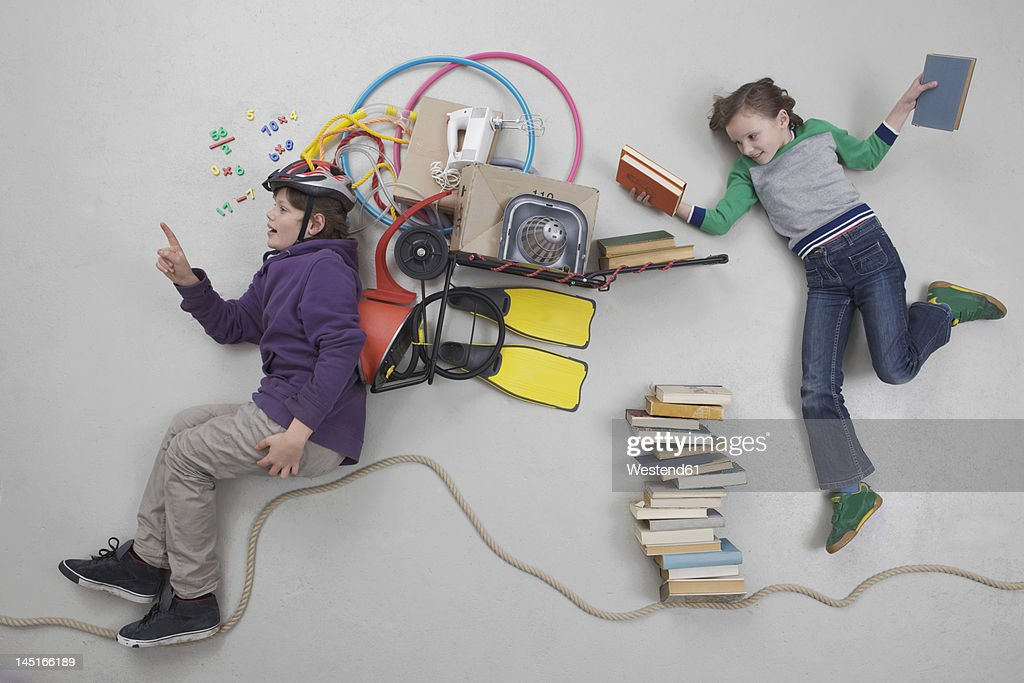 Boy calculating while girl holding books