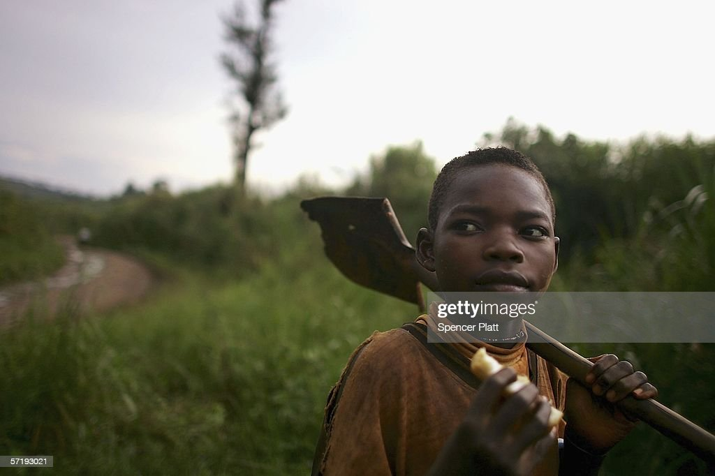 A boy carries a shovel on his way home from the gold mine pits March 27, 2006 in Mongbwalu, Congo. Thousands of Congolese scrape together meagre livings from mining. Gold and other mineral deposits, which are numerous in the volatile north-east of the country, have become a catalyst to much of the conflict in Congo. The Democratic Republic of Congo (DRC), a country that loses an estimated 1,400 people per day due to war since 1998, is struggling to hold Presidential elections this summer. The volatile East of the country, which is situated hundreds of miles from the capital Kinshasa, has been the focal point of continued violence. Numerous militias and warlords have vied for control of the mineral rich eastern Congo for decades, creating instability and continued bloodshed.