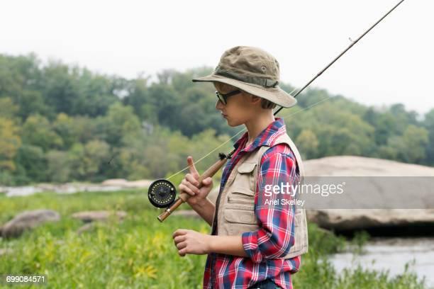 Boy carrying fishing rod