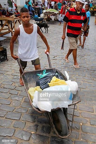 Boy carrying goods on Santo Amaro market