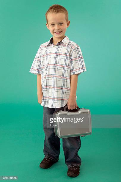 Boy Carrying Lunchbox