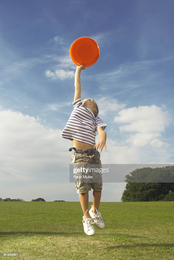 boy catching frisbee