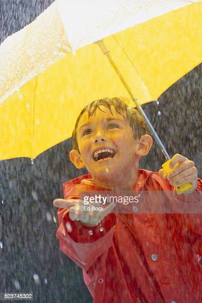 Boy Catching Rain