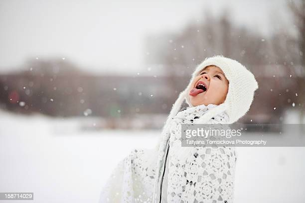 Boy, catching snowflakes with a tongue