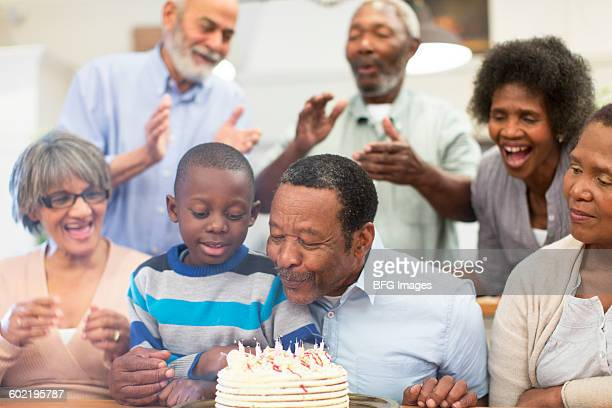 Boy (8-9) celebrating birthday with grandfather , Cape Town, South Africa
