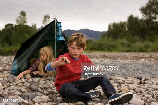 Boy checking fishing line : Stock Photo