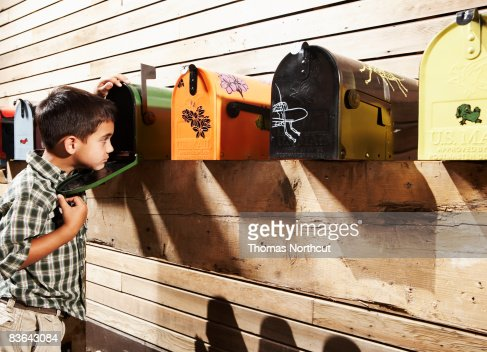 boy checking for mail : Stock Photo