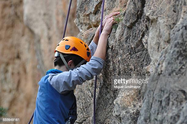 Boy climbing in rock