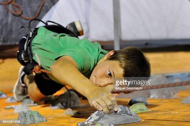 Boy climbing in rockodromo