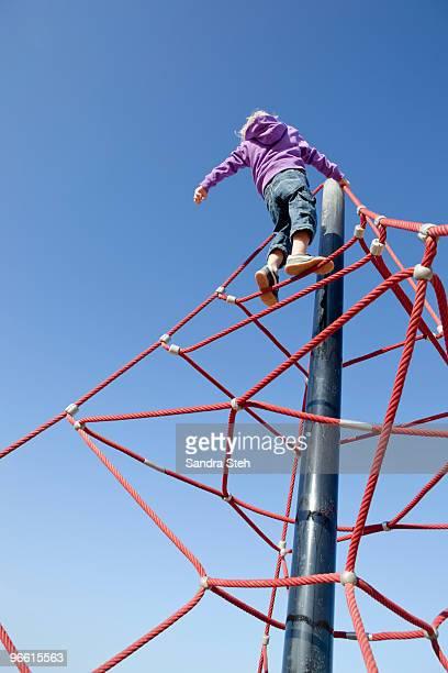 Boy climbing junglegym