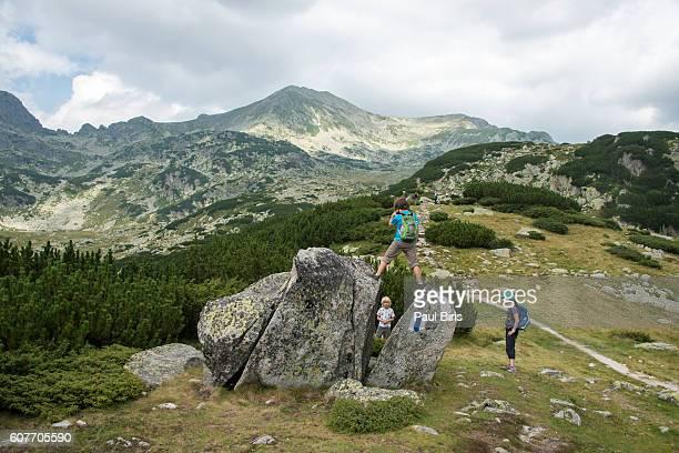 Boy climbing on rock, Retezat Mountains, Romania