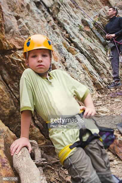 Boy climbing rocks
