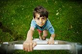 Boy climbs ladder