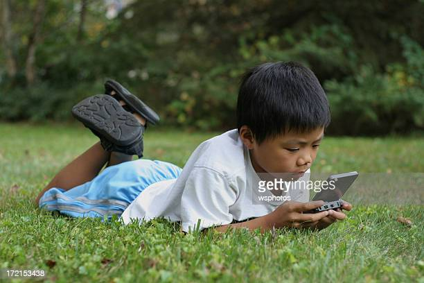 Boy concentrating on a video game