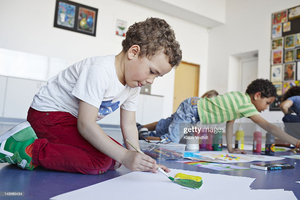 Boy concentrating on drawing : Stock Photo