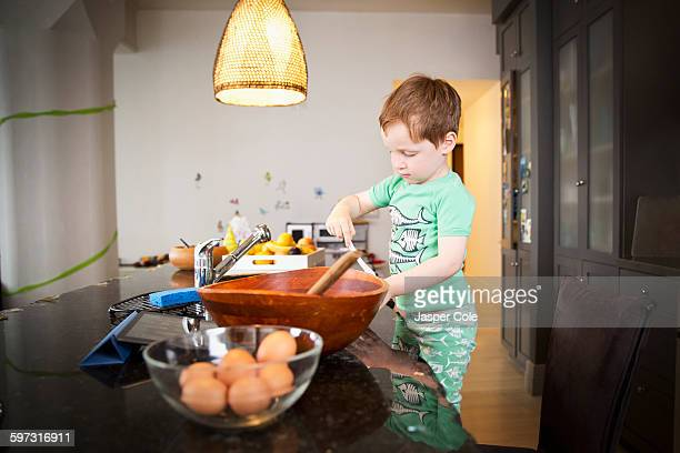 Boy cooking in kitchen