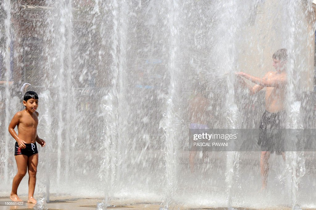 A boy cools off in a fountain, on August 21, 2012 in Albi, southwestern France, as the city swelters under a summer heatwave. The number of departments in heatwave orange alert was reduced by half, from 16 to 8, announced on August 21, 2012 by the French national meteorological service Meteo, indicating that the heatwave 'is coming to the end.' The eight departments which are still under orange alert are the Ain, Allier, Haute-Garonne, Isere, Loire, Puy-de-Dome, the Rhône and the Tarn.