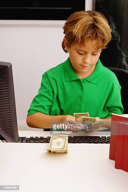 Boy counting currency notes