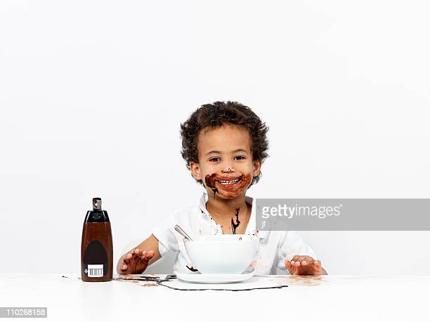 Boy covered in chocolate sauce