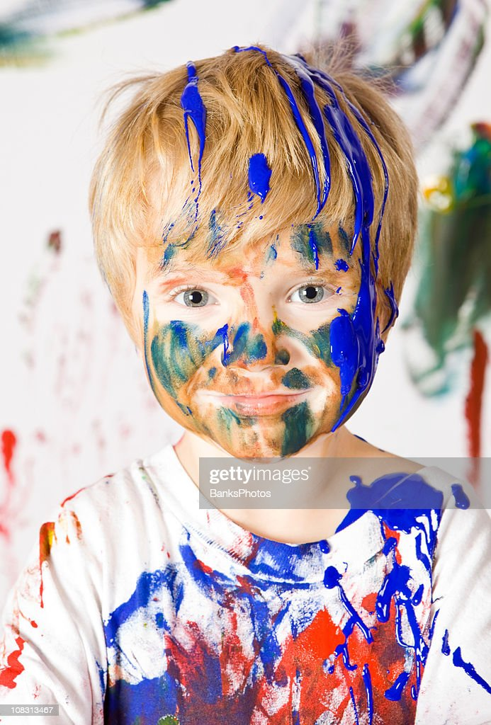 Boy Covered with Paint : Stock Photo