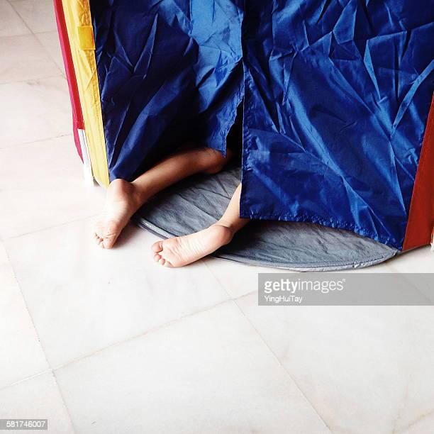 Boy crawling into a tent