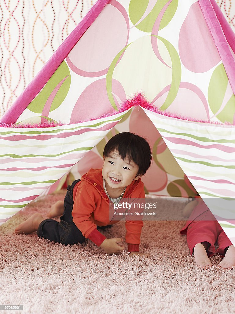 Boy Crawling Out of Tent : Stock Photo