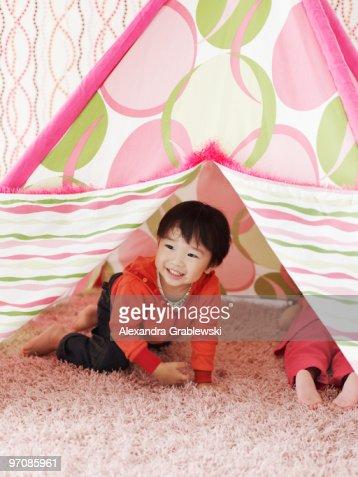 Boy Crawling Out of Tent : Foto de stock
