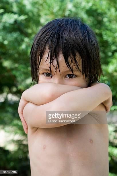 A boy crossing his arms
