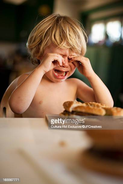 Boy crying at table