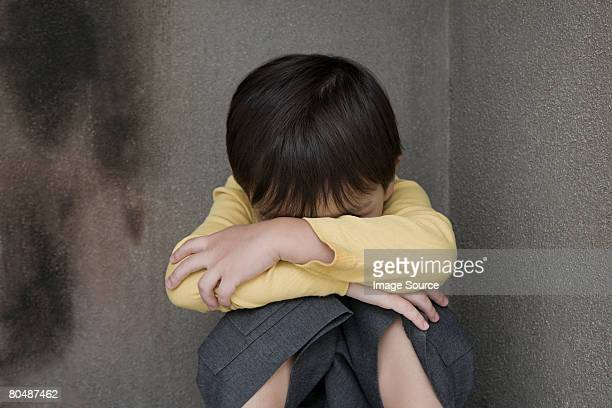 Boy crying in a corner
