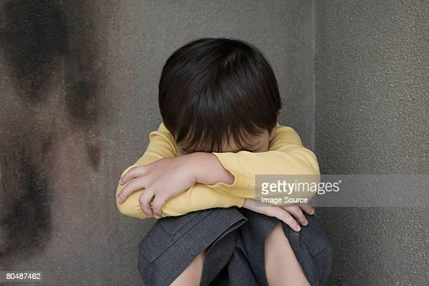 Boy crying in a corner
