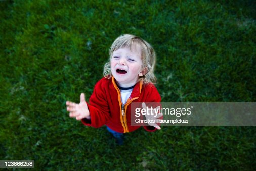 Boy crying in garden