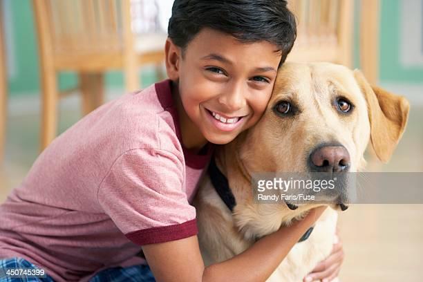 Boy Cuddling with Dog