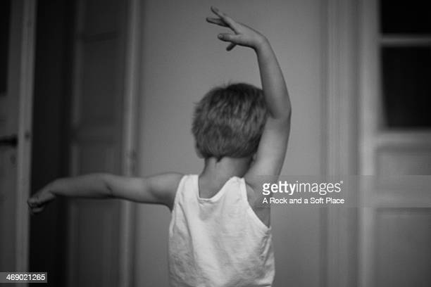 Boy dances with arms in air