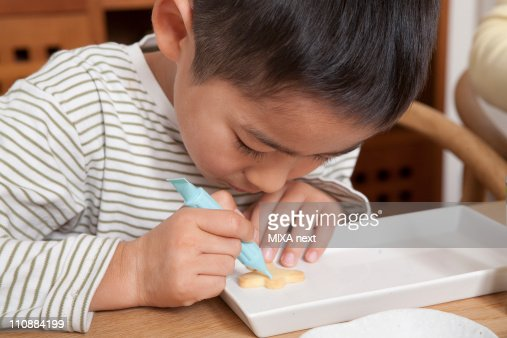 Boy Decorating Cookie : Stock-Foto