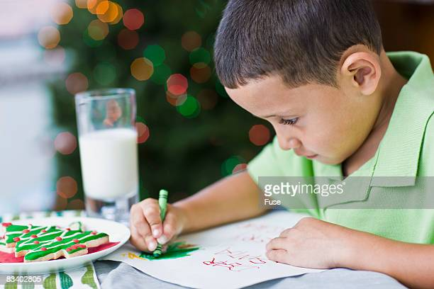 Boy Decorating Letter to Santa Claus