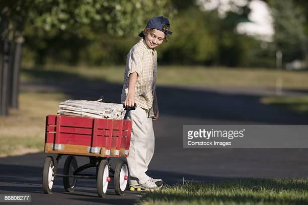 Boy delivering newspapers