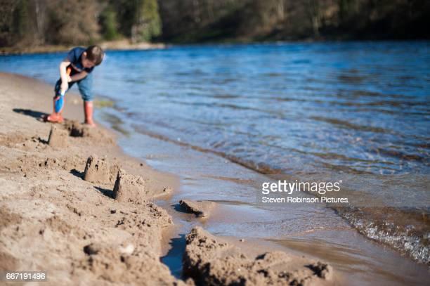 Boy Digging Sand on Beach II
