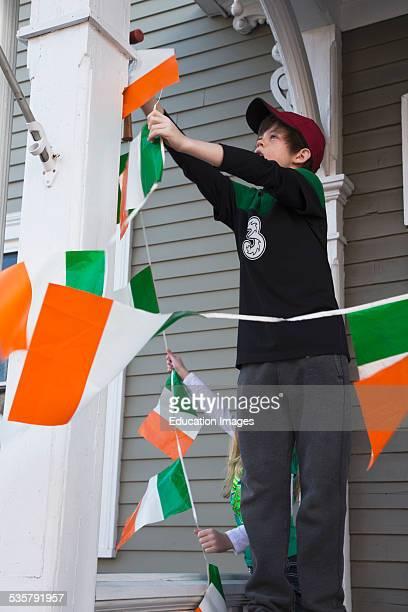Boy displays Irish flag St Patricks Day Parade South Boston Massachusetts