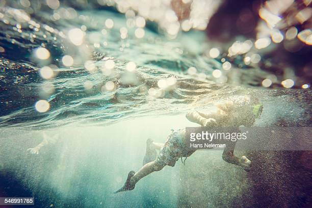 Boy diving in the sea, underwater view