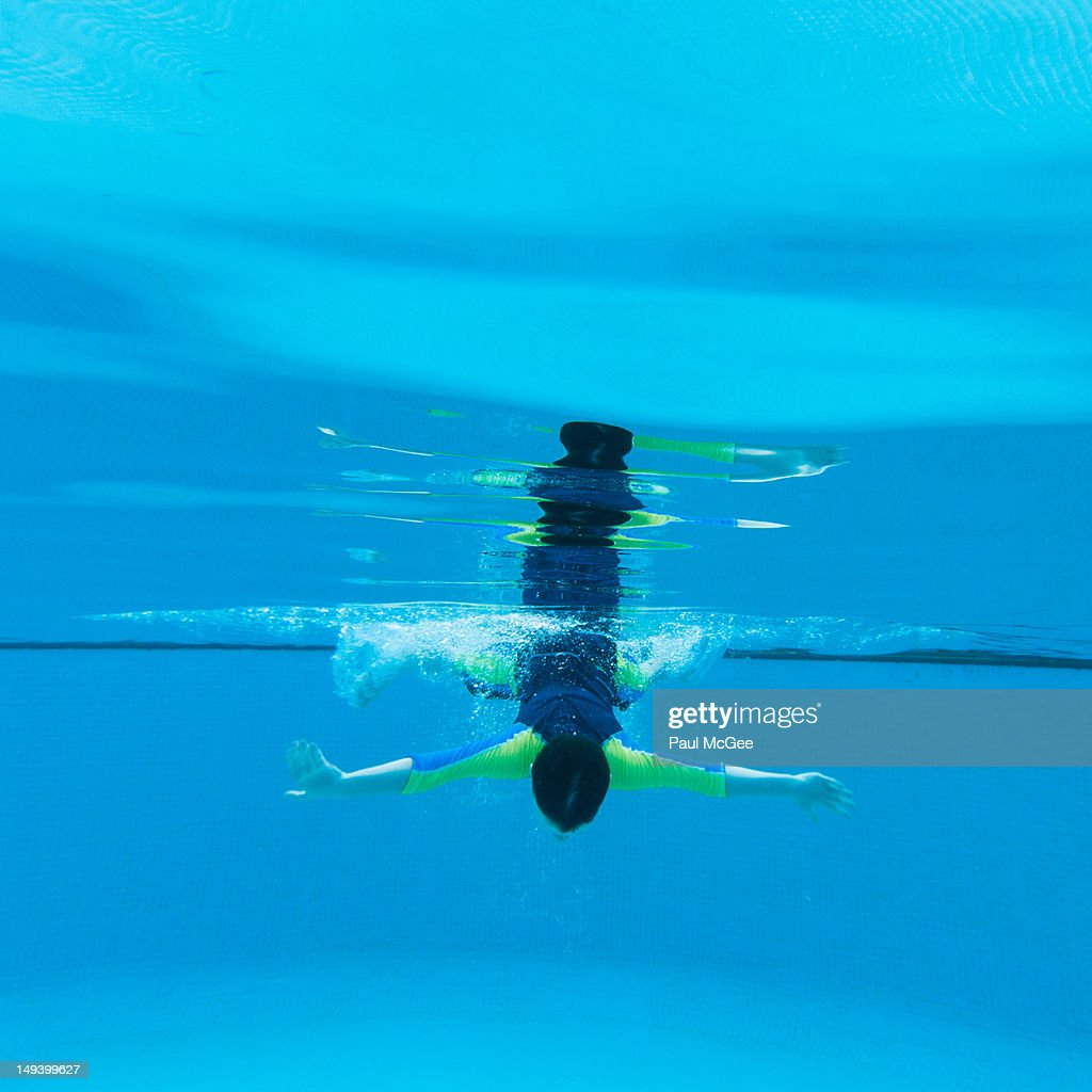 Boy Diving Into Pool Stock Photo