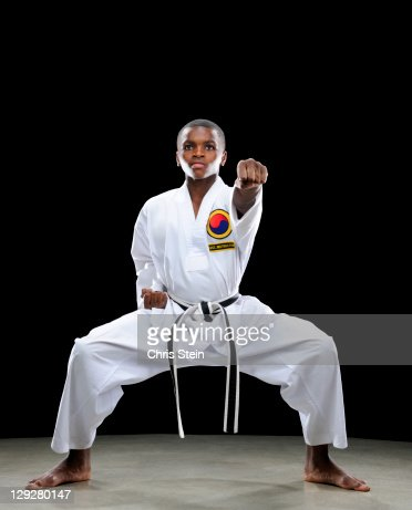 Boy doing a Karate Front Punch : Foto de stock